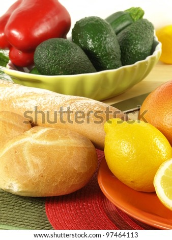Roll and baguette with avocado for breakfast - stock photo