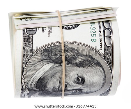 Roll of banknotes on plain background - stock photo
