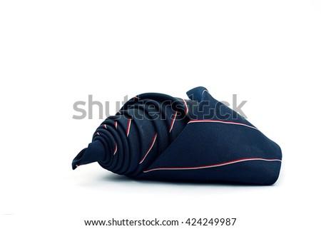 Roll of Dark blue necktie on white background - stock photo