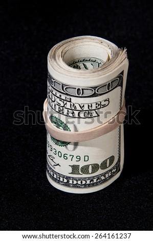 Roll of $100 dollar bills - stock photo