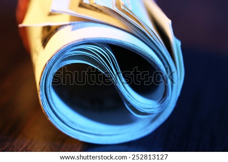 Roll of dollars on wooden table background - stock photo
