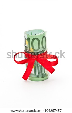 Roll of Euro money and red bow on white background - stock photo
