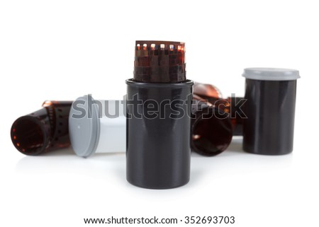 Roll of film for film camera. Isolated on white background object, horizontal - stock photo