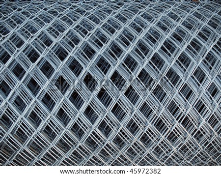 roll of gray steel Chicken Wire - stock photo