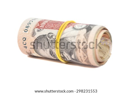 Roll of Indian rupees isolated on white  - stock photo
