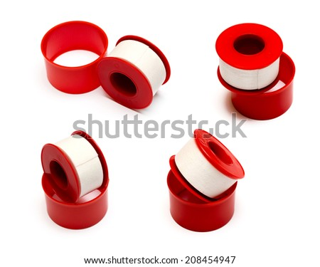 Roll of medical sticking plaster isolated on white - stock photo