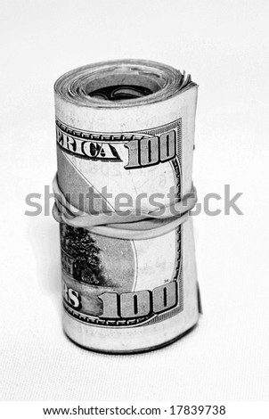 roll of money wrapped with an elastic - stock photo