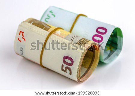 Roll of one hundred euro and Fifty banknotes with a rubber band, isolated on the white background, clipping path included. Full focus. - stock photo