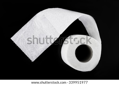 Roll Of Toilet Paper Isolated On Black Background - stock photo