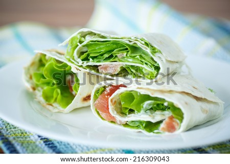 roll pita with salad and salted salmon - stock photo