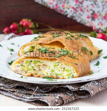 Roll, strudel from pancakes, crepes with zucchini, ham, cheese, creamy taste, delicious breakfast - stock photo