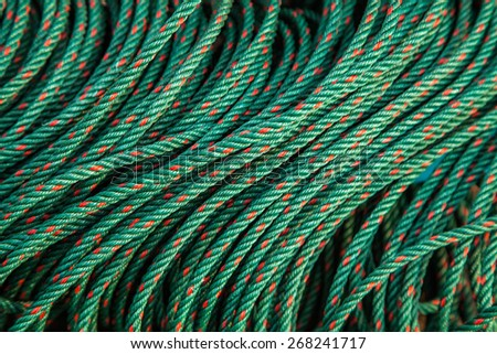roll texture of green nylon rope - stock photo