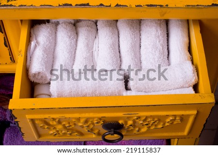Roll Towels overlap,Soft colorful warm blankets in the seizures products,Towels in open drawer close up - stock photo
