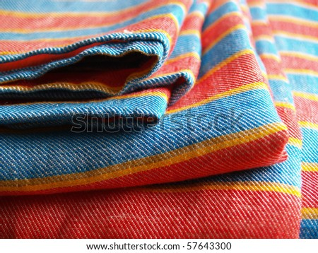 roll up striped flax table-cloth - stock photo