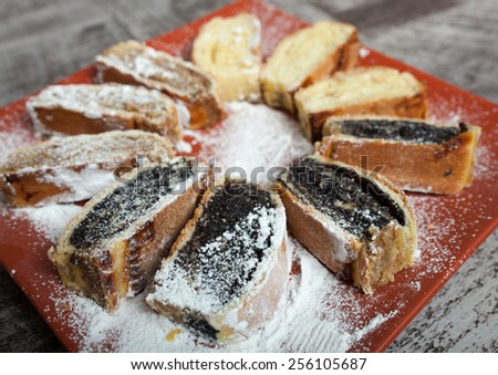 Roll with poppy seeds, walnut and cheese - stock photo