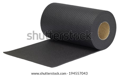 rolled black rubber mat in white back - stock photo