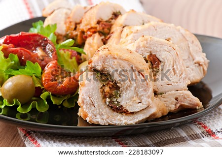Rolled Chicken with spinach and sun-dried tomatoes - stock photo