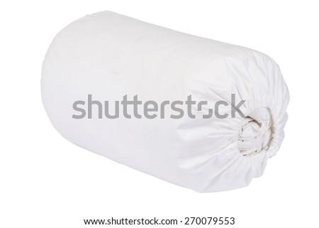 Rolled duvet cover on white - stock photo