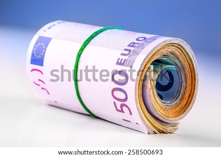 Rolled euro banknotes several thousand.Free space for your economic information - stock photo