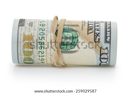 rolled hundred dollar banknotes tied with rubberband - stock photo