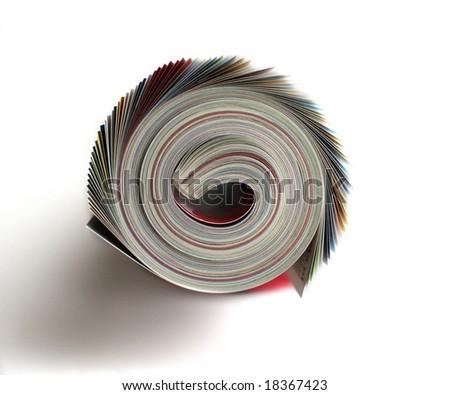 rolled magazine isolated on white - stock photo