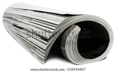 Rolled magazine on white background. - stock photo
