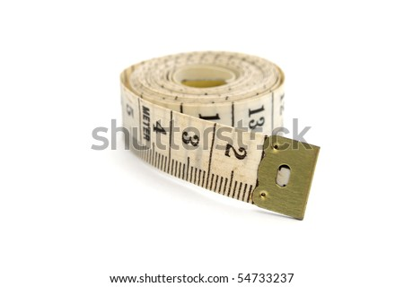Rolled measuring tape isolated on white background - stock photo