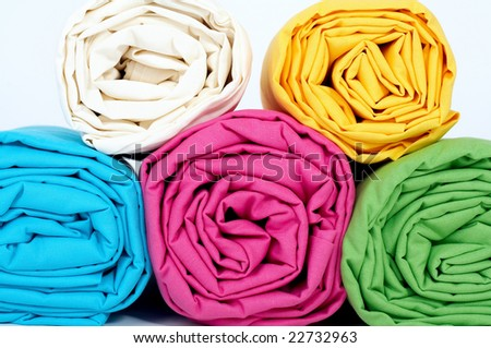 Rolled multicolored sheets - stock photo