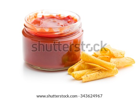 rolled nacho chips and salsa dip on white background - stock photo