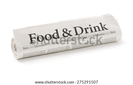 Rolled newspaper with the headline Food and Drink - stock photo