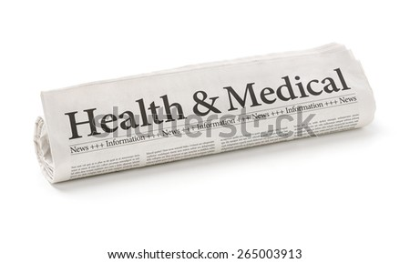 Rolled newspaper with the headline Health and Medical - stock photo