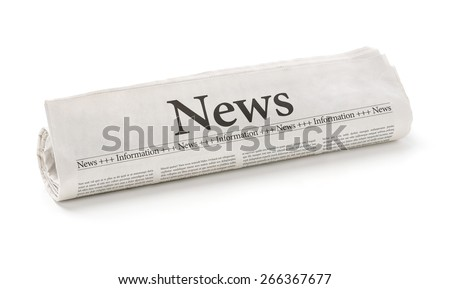 Rolled newspaper with the headline News - stock photo