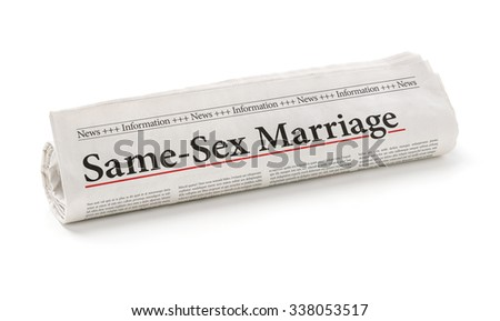 Rolled newspaper with the headline Same-Sex Marriage - stock photo