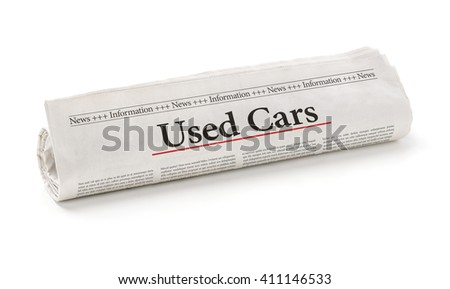 Rolled newspaper with the headline Used Cars - stock photo