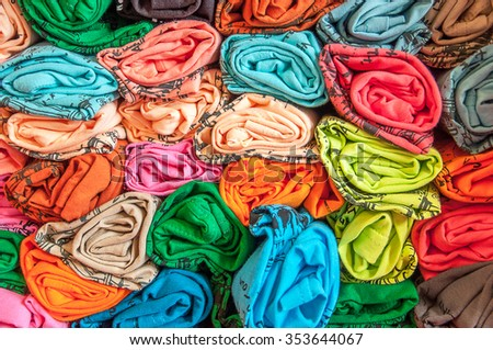 Rolled of  T-shirts stacked  - stock photo