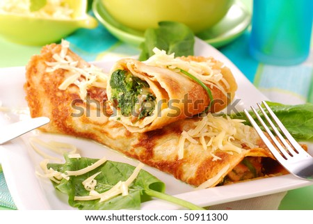 rolled pancakes stuffed with the  spinach - stock photo