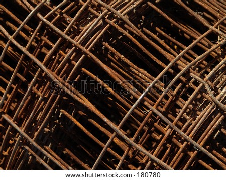 rolled rusted wire fence - stock photo