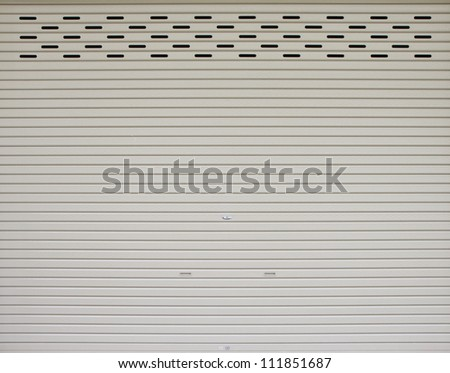 Rolled steel doors - made of steel sheet. - stock photo
