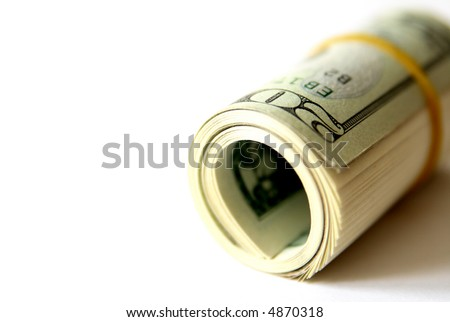 Rolled up dollar bills with room for text, shallow dof - stock photo