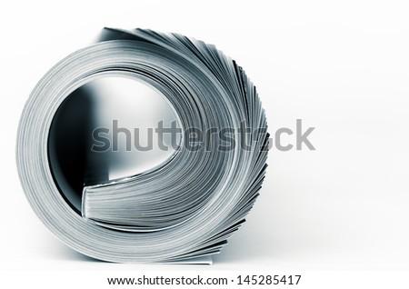Rolled up magazine macro - stock photo
