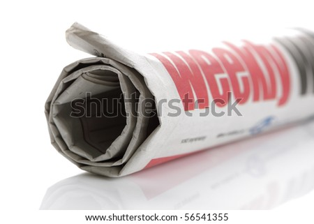 Rolled up newspaper on white background - stock photo