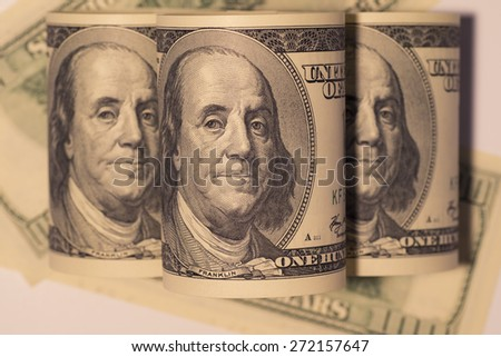 Rolled up one hundred dollar bills - stock photo
