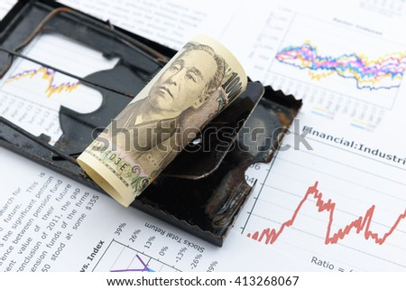 Rolled up scroll of JPY Japanese yen bill as a bait on a black rat trap. A symbol of an economic trap that Japan currently faces and difficult / hard to escape. Financial / inflation crisis concept. - stock photo