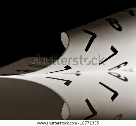 Rolled up sheet of paper with numbers on a reflective surface - stock photo