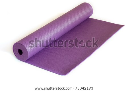 Rolled up yoga mat isolated on white - stock photo
