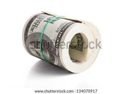 Rolled Us Dollar Notes Over White Background - stock photo
