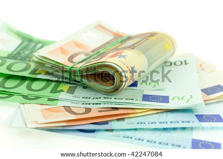 rolled with rubber euro notes on white background. closeup. small GRIP - stock photo