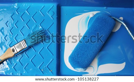 Roller and Brush With Blue and White  Paints - stock photo