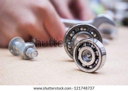 roller bearing and mechanic with tools - stock photo