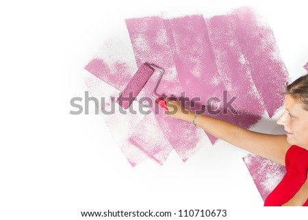roller brush with pink pain - stock photo